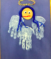 Avi's Christmas Angel! We love the little handprints from our 2.9 scholars!