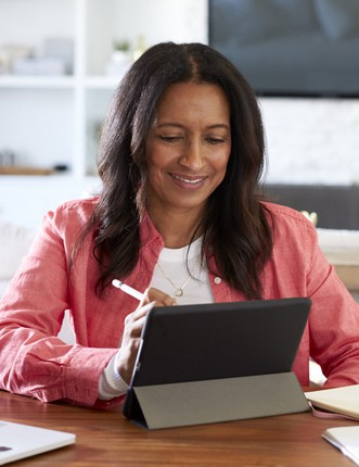 Female teacher using tablet to learn