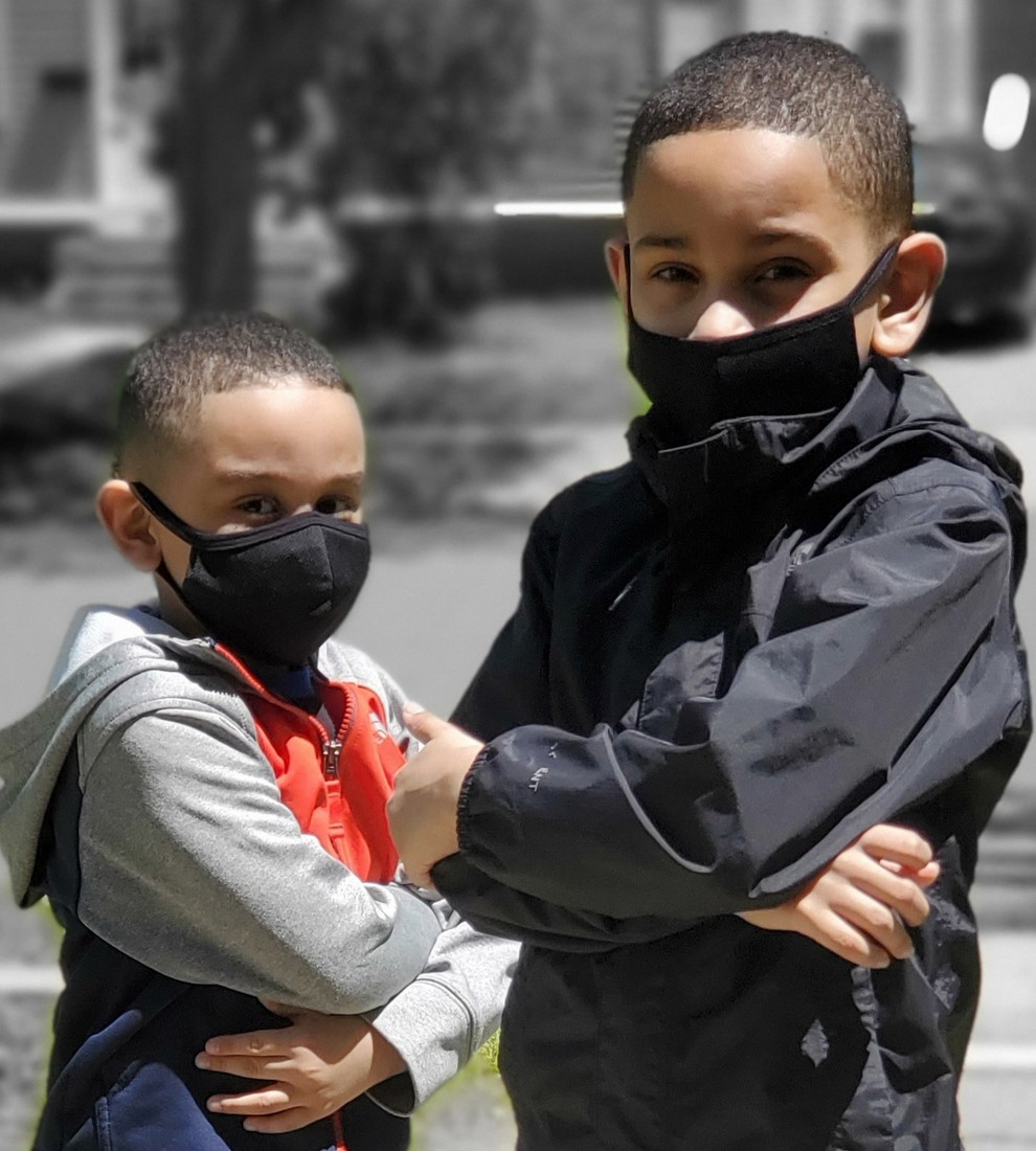 Two young HPS students wearing their masks and helping to slow the spread of COVID-19.