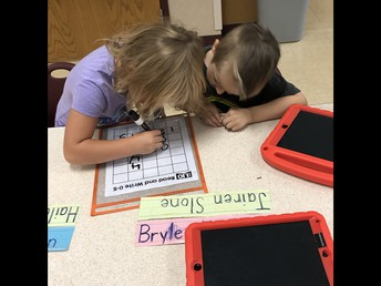 Kindergarten kids working with partners