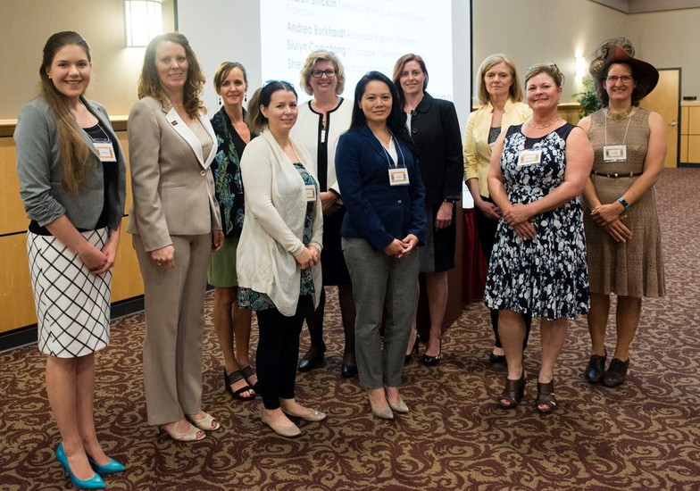Dr. Sabrina Hessinger hosting the Women in STEM Industry Luncheon on Armstrong Campus with Dean Nivens and STEM professionals (from Gulfstream, O'Brien & Gere Engineers, Inc., Customs and Border Protection Laboratory, and Georgia Bureau of Investigation). She is seen 3rd from the left in a black and green shirt.