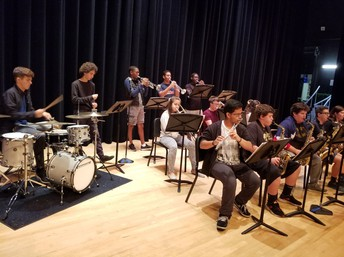 Students playing instruments on a stage