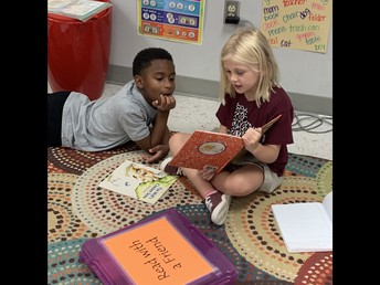 Reading with a friend is always fun!