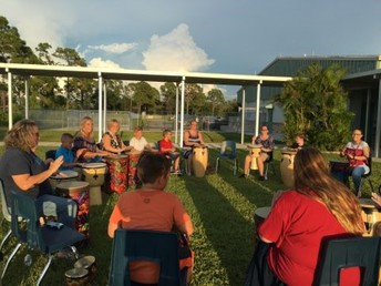 Drum Circle with Mrs. Holycross at the Mother/Son NIght of Fun