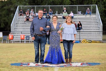 Kirk and Melissa Beasley with their daughter, Annie.