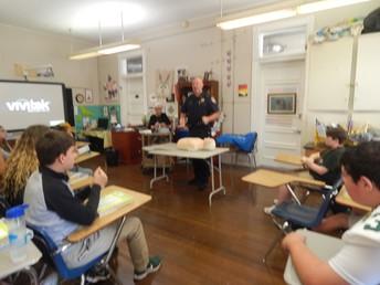 Officer Paul Payne explaining CPR procedures