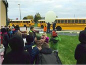 Students watch as a weather balloon inflates.