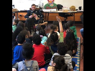 Officer Summer reads to Grade 1