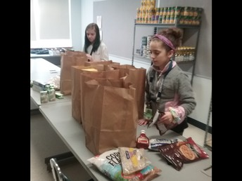 Kindness Club helps out in the food pantry.