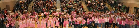 Image of the Annual BHS Pink Out hosted by CIC. There is a large group of individuals wearing pink in the gym.