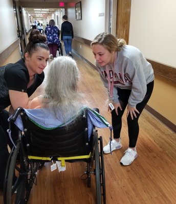Students engage with residents at an area nursing home