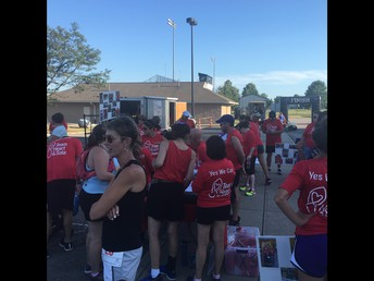 Game Day 5k runners prep with Team Heart & Sole champions prior to the race.