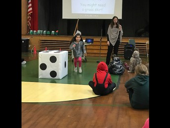 Ms. Crowther leading students through a game at Monday Morning Meeting