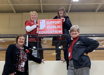 Look Who Supported Public Education at the Boys Basketball Game!