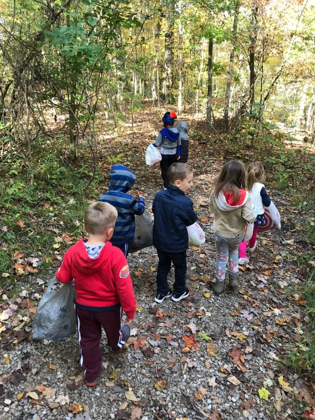 Tiny Toppers exploring nature and collecting leaves.