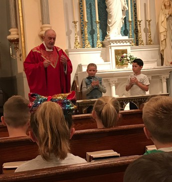 Second Grade Gets to Enjoy Mass with Fr. Mooney