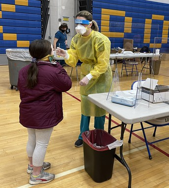 Nurse administering a COVID test