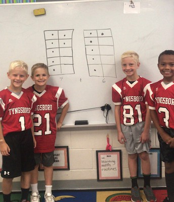 2nd Grader Tigers from Mrs. Nicosia's class solving math problems