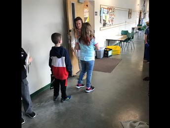 Ms. O'Kelley greeting & welcoming her students as they enter for the day!