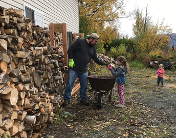 Hannah helps dad stack wood!