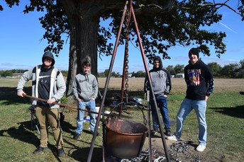 FFA students making apple butter