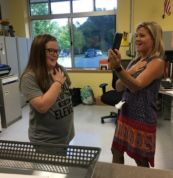 Leia and Mrs. Gough, saying the Pledge of Allegiance.