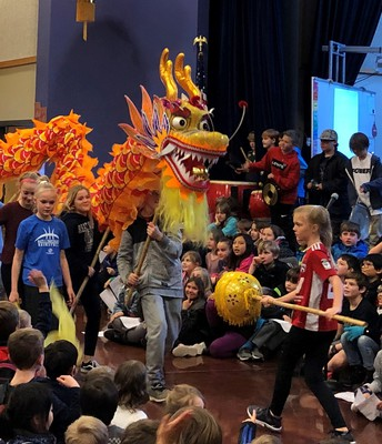 The Yellow Dragon will dance to the rhythm of the gong and cymbals.