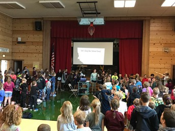 CES 6th graders leading the school song