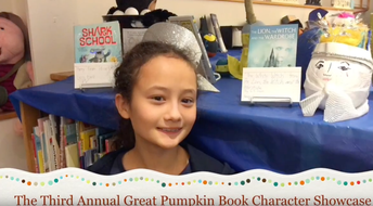 ISD student posing infront of a collection of books for the 3rd Annual Great Pumpkin Book Character Showcase