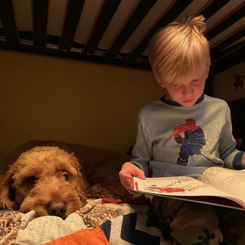 Logan reading to a special friend