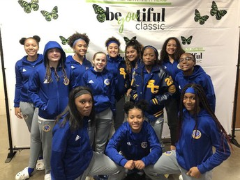 lady buffs basketball poses for a team photo at the bee-you-tiful tournament