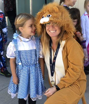 It's the Lion (Ms. Haft) and Dorothy from Wizard of Oz