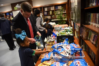 Mayor Walsh helps Jade from K2A fill her Blessing Bag.