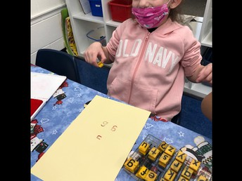 Stamping lowercase letters in Kindergarten