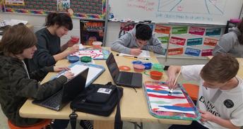 Adding paint in 8th grade art studio