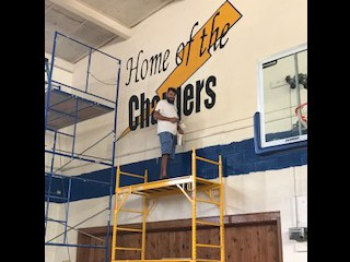 Mr. Ramon Garcia painting our gym