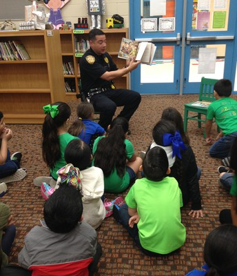 reads to first graders