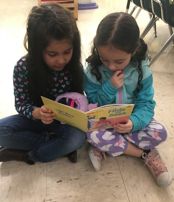 Students reading to each other during Read Across America Day!