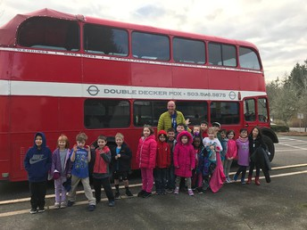 First graders exploring a double decker bus