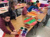 2nd Graders working on ornament painting in art!