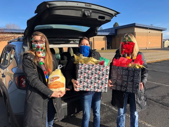 Henley High School counselors get ready to deliver baskets