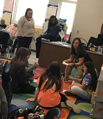 Teachers observing Ms. Lunsford's small group learning about similes and metaphors.