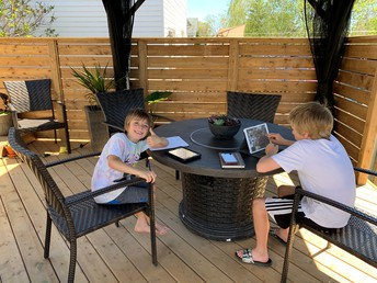 Matthew and his brother engaged in OUTSIDE distance learning