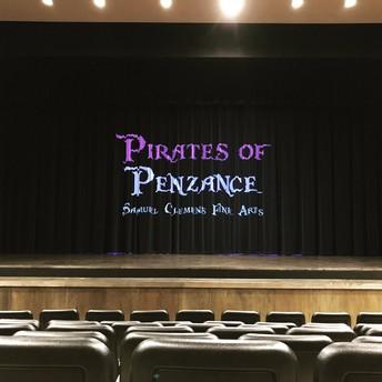 "image of theatre curtain reading ""pirates of penzance samuel clemens fine arts"""