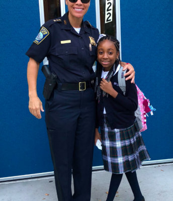 Deputy Baston welcome Aaryn Alexis back to school!