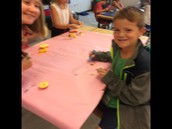 All smiles as we get to play with our food at the table.