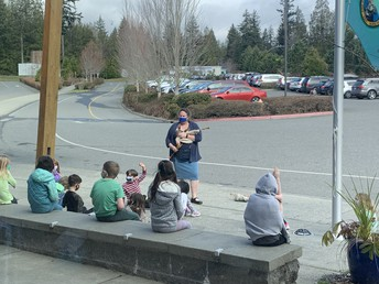 Mrs. McMeel shared her bagpipes with 1st grades in front of the school.