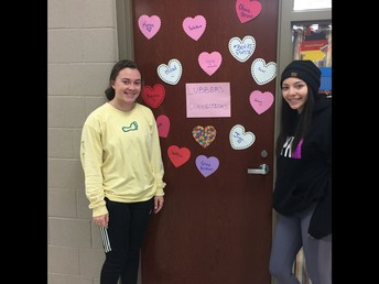 Connections students showing off door decorations for Valentine's Day
