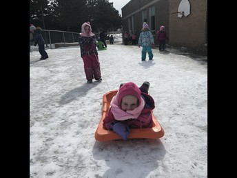 Enjoying the February sun with our kinder friends and outdoor sleds