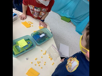 This math game in Grade 1 had students continually manipulating and adding numbers in their race to the finish